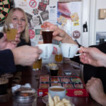 Friends cheer with glasses at New Limburg Brewery