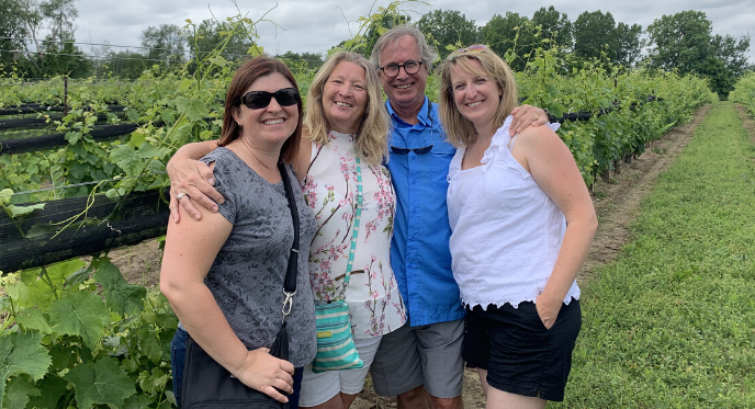 Group posing in the vineyard